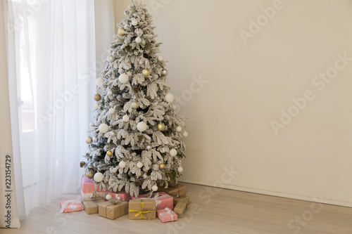 apartment decor for the new year Christmas tree and gifts