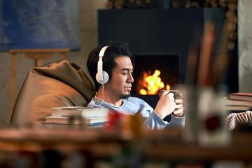 Male artist was listening to music