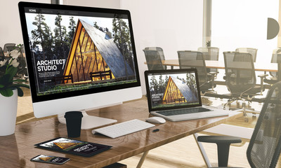 computer, laptop, tablet, and phone with architect studio website at office mockup