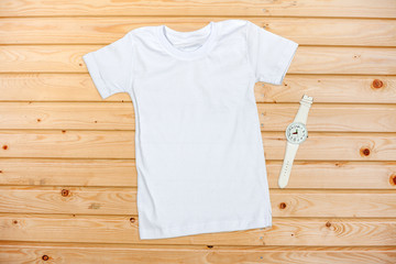White Short Sleeve T-Shirt on a Wooden Background