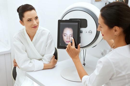 Face Skin Analyze. Cosmetologist Analyzing Woman Facial Skin