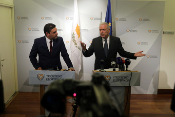Cypriot Interior Minister Constantinos Petrides and European Commissioner for Migration, Home Affairs and Citizenship Dimitris Avramopoulos talk during a news conference in Nicosia