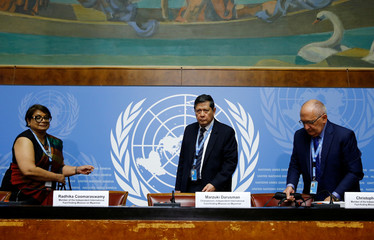 Members of the  Independent International Fact-finding Mission on Myanmar attend a news conference at the UN in Geneva