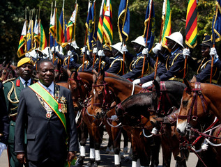 Zimbabwe's President Emmerson Mnangagwa arrives for the opening of Parliament in Harare