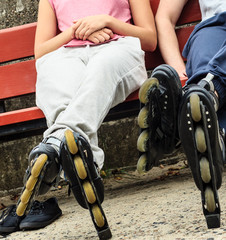 People friends relaxing with roller skates.