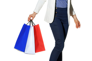 happy woman with shopping bags on white looking at copy space
