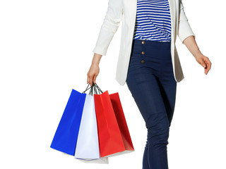 smiling shopper with shopping bags on white background walking