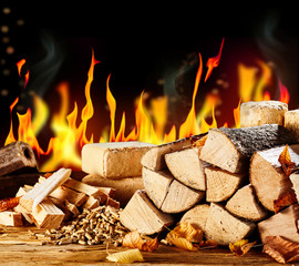 Wood logs sitting in front of flaming background