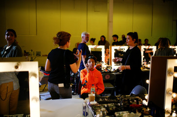 Models prepare backstage of the Natasha Zinko catwalk show during London Fashion Week in London