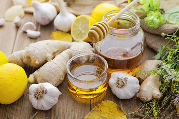 Honey, ginger, garlic, lemon and herbs. Alternative medicine
