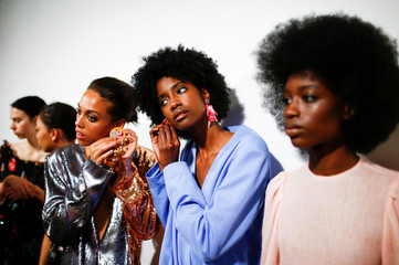 Models prepare backstage of the Roberta Einer show during London Fashion Week in London