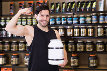 man showing  biceps and sport nutrition