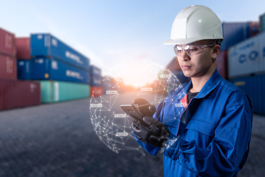 The abstract image of engineer point to the hologram on his smartphone and blurred container yard is backdrop. the concept of communication network internet of things and logistic.