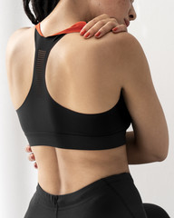 Woman in athletic wear  embracing herself - Support