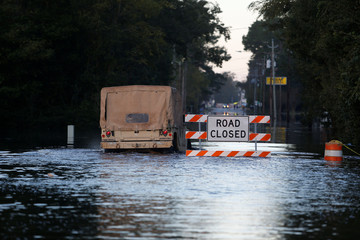 The National Guard navigates through flood waters in the aftermath of Hurricane Florence in Fair Bluff
