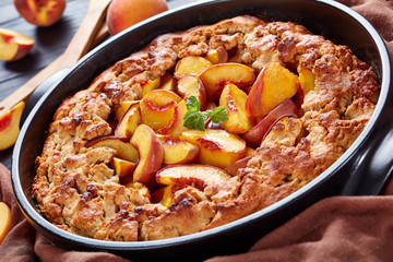 Peach Cobbler a deep-dish fruit dessert, good for the breakfast, cooked in advance meal, close up