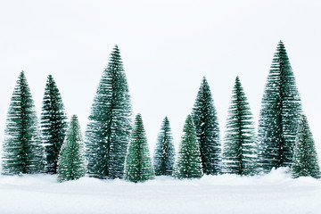 Christmas trees on the snow in winter. Christmas holiday celebration and new year concept. copy space