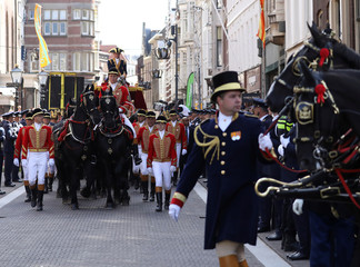 Dutch King Willem-Alexander and Queen Maxim waves arrive at the Noordeinde Royal Palace in the Hague