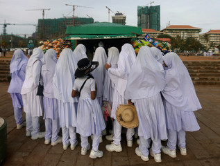 Muslim girls are seen at a food stall at the Galle Face Green in Colombo