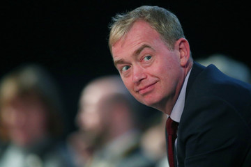 The former leader of the Liberal Democrats, Tim Farron, prepares to listen to the current leader Vince Cable, address his party's annual conference in Brighton