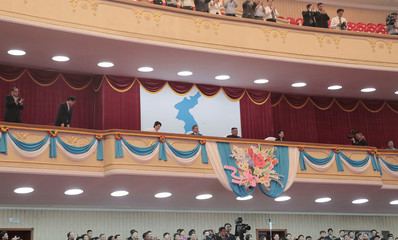 South Korean President Moon Jae-in talks with North Korean leader Kim Jong Un as they watch an art performance at Pyongyang Grand Theatre in Pyongyang