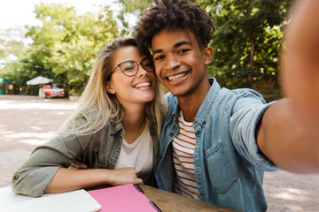 Excited young multiethnic couple spending time together