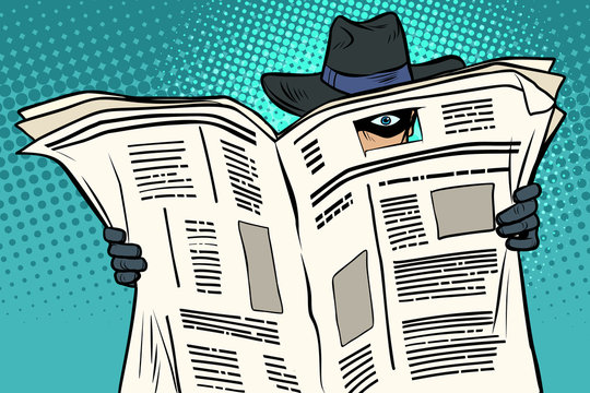 spy watches through the newspaper