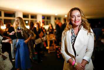 Designer Alice Temperley poses backstage following her show at London Fashion Week in London