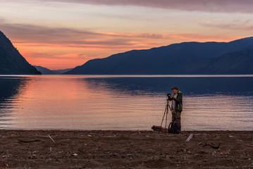 photographer sunset lake mountains