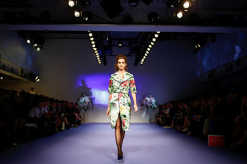 Models present creations at the Richard Quinn catwalk show during London Fashion Week in London