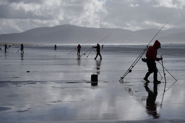 People participate in the Diawa Irish Pairs sea angling event in windy conditions on the Dingle Peninsula of Inch beach in Inch