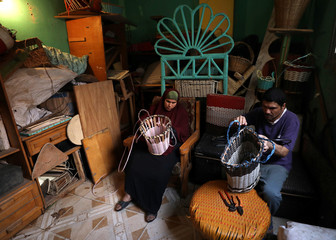 Heba and Samir, a married couple who are both visually impaired, weave bamboo baskets in Cairo
