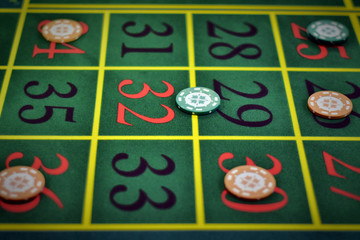 Game chips are on the table in the casino