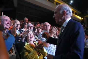 The leader of the Liberal Democrats, Vince Cable, is congratulated after addressing his party's annual conference in Brighton