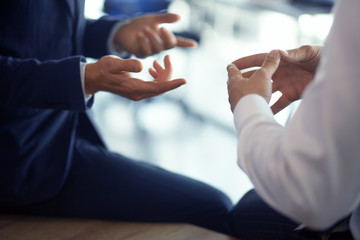 Close up of men hands making gestures while speaking in office. Business concept. Wall mural