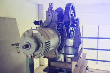 Motor driven with sling cable and wheel in control room