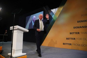 The leader of the Liberal Democrats, Vince Cable, waves after addressing his party's annual conference in Brighton