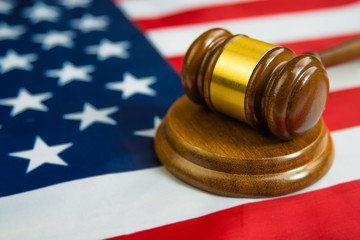 hammer of the judge on the flag of the United States of America. Court, law, crime and. gavel.