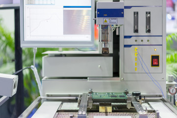 Inspection electronic circuit board by automate vision system show result on monitor in the factory