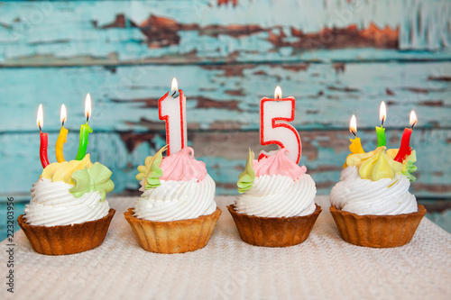 Happy Fifteenth Birthday Cakes And Red Number 15 Candles On Blue Vintage Background