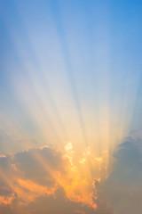 Beautiful sun beams along the sky after the sunset.