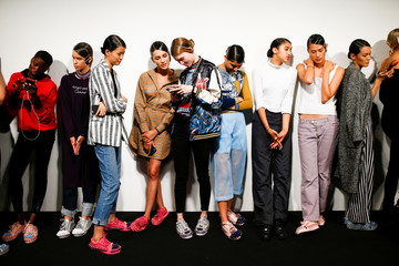 Models prepare backstage of the On|off catwalk show during London Fashion Week in London