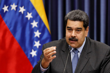 Venezuela's President Nicolas Maduro talks to the media during a news conference at Miraflores Palace in Caracas
