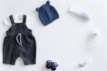 View from above of fashion trendy stuff on white background for newborn baby boy, flat lay.