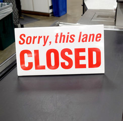 Red and white grocery store checkout lane sign: SORRY, THIS LANE CLOSED.