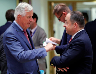 Polish Minister for European Affairs Designate Konrad Szymanski and European Union's chief Brexit negotiator Michel Barnier attend an EU's General Affairs Council in Brussels