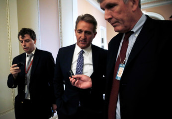 U.S. Senator Flake is questioned by reporters about Kavanaugh Supreme Court nomination on Capitol Hill in Washington