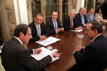 Cypriot President Nicos Anastasiades and Tarek El Molla, Egypt's Minister of Petroleum and Mineral Resources, talk during a meeting at the Presidential Palace in Nicosia