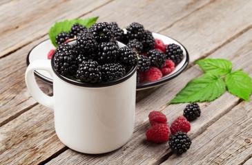 Cup of ripe blackberries and raspberries