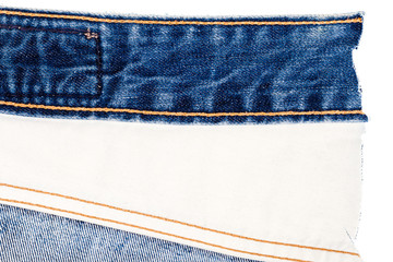 Piece of blue jeans and white fabric